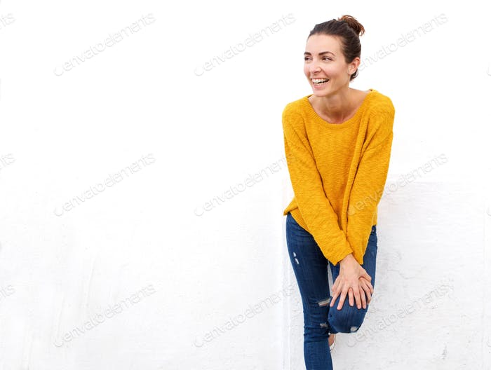 cheerful caucasian female looking away and smiling on white background