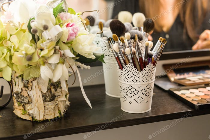 Makeup brushes in the beauty salon.
