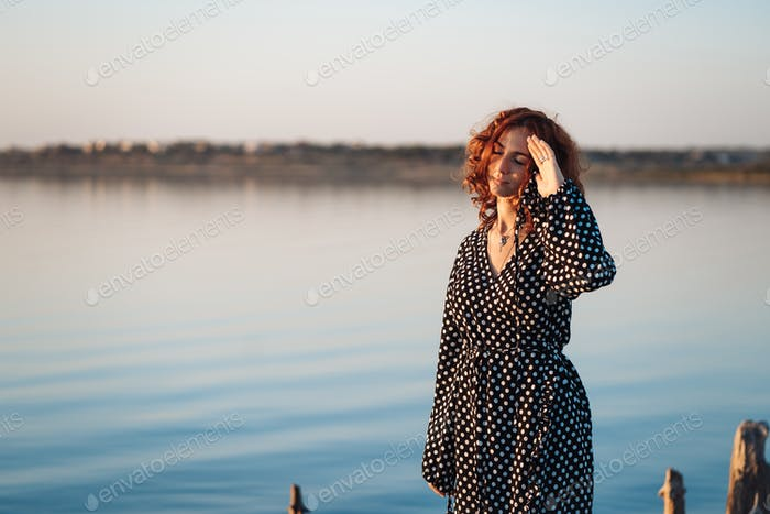 woman with closed eyes on the beach