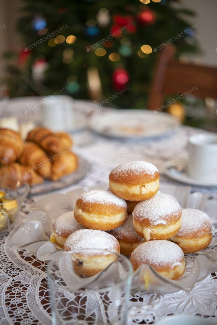 Christmas table with croissants and donuts