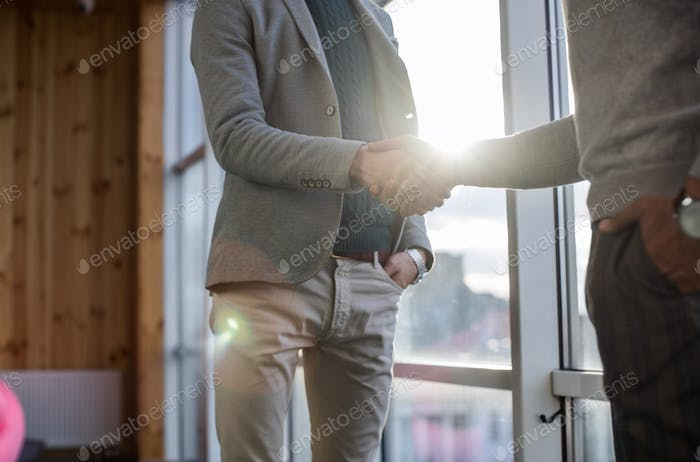 Two Business Man Shake Hand Agreement Coworking Center Business Team Coworkers Stand In Front Big