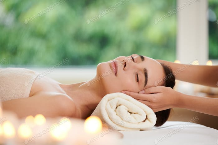 Woman getting massage from therapist