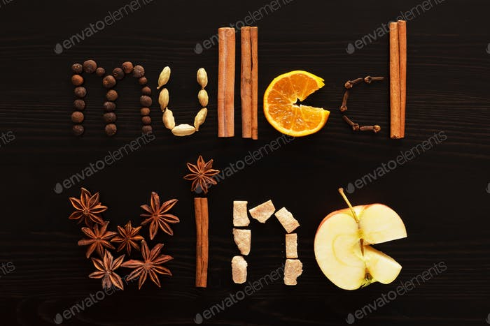 text mulled wine made from slice of orange, spices on the black background