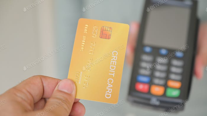 Close - up shot of Customers pay by credit card via EDC.