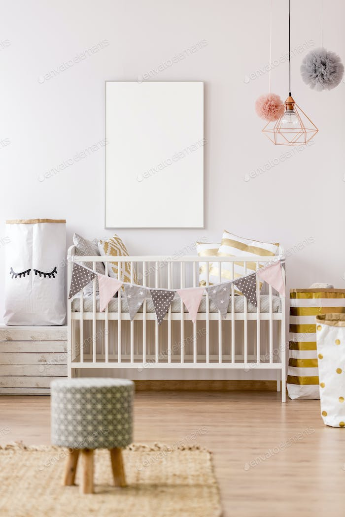 White frame mockup in baby nursery