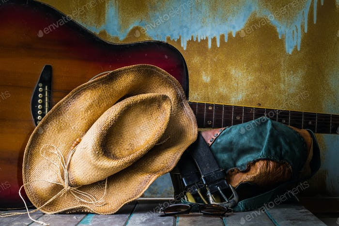 Hat and guitar on wooden
