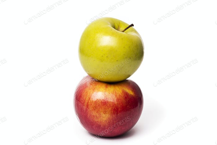 Two apples, Red Delicious and Granny Smith, isolated on white ba