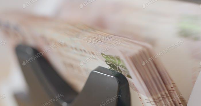 Electronic counting machine of Hong Kong banknote close up