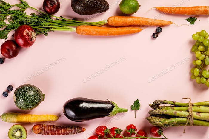 Fruits and vegetables on pink background, flat lay, top view