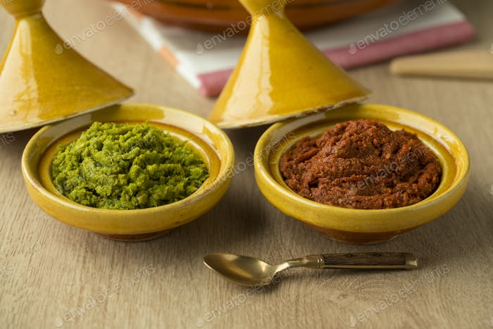 Red and green harissa close up