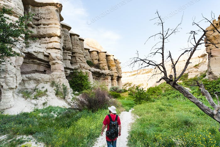 tourist walks in ravine near Goreme in Cappadocia
