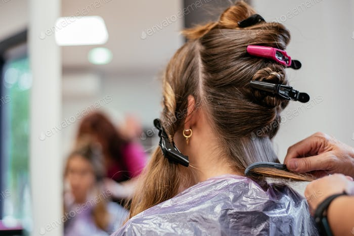 Hairdresser with woman client