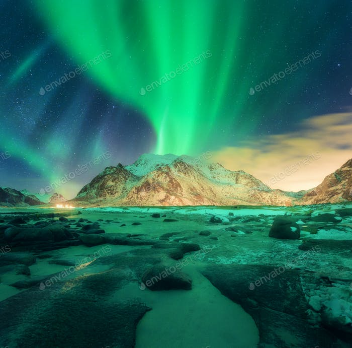 Aurora over snowy mountains. Northern lights