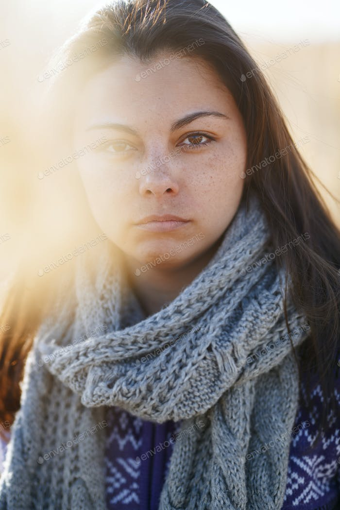 Worried woman outdoors looking at camera