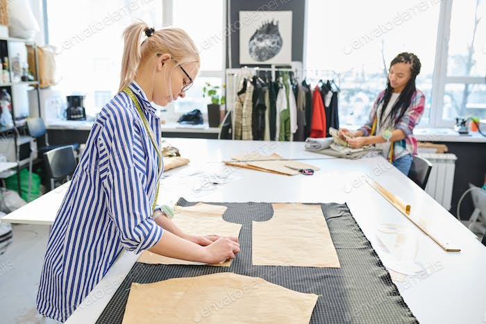 Dressmakers working in atelier