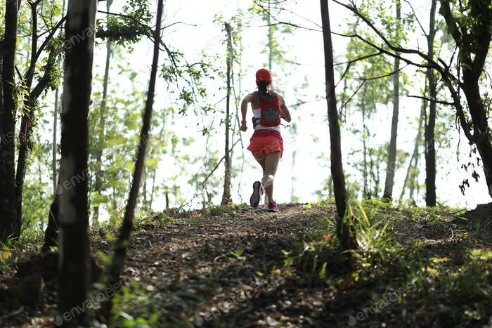 Ultra marathon runner running in forest