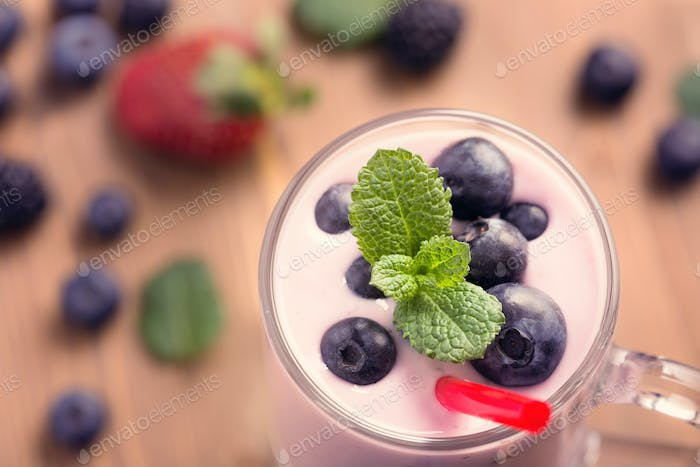 Glass of blueberry smoothie with mint