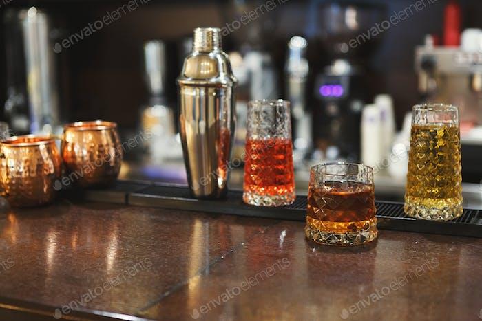 Creative alcoholic cocktails assortment on bar