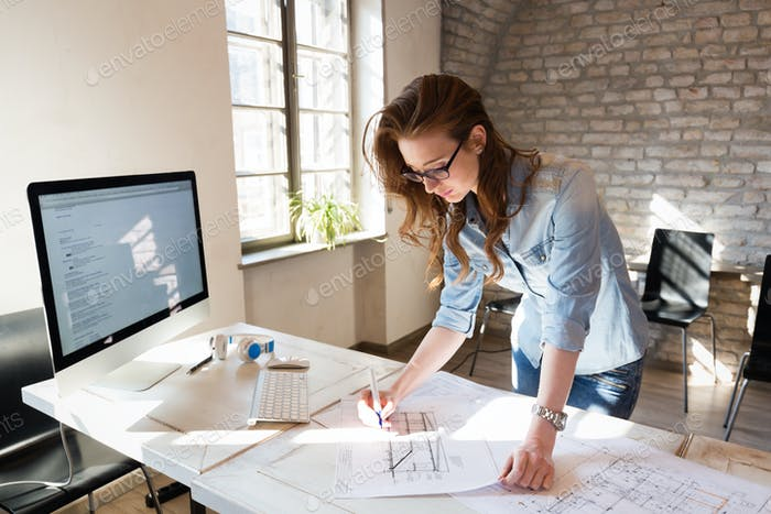 Picture of young architect working in office
