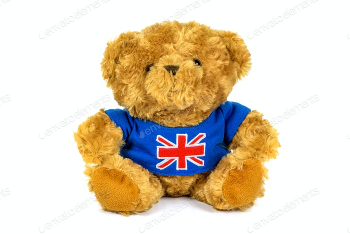 Teddy bear with UK flag on white background