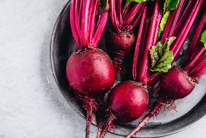 Bunch of fresh raw organic beets with leaves