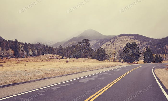 Color toned road on a cloudy day, Colorado, USA.