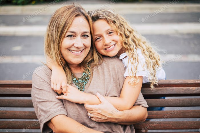 mommy and daughter cheerful portrait outdoor