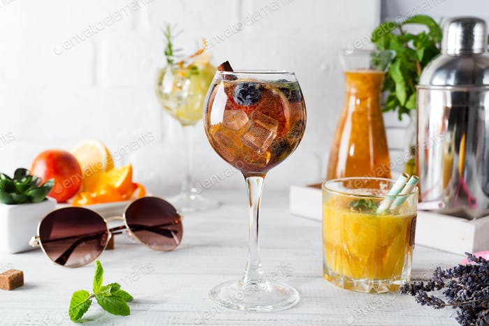 A glass of cocktail and a glass with an orange cocktail or fresh and tonic