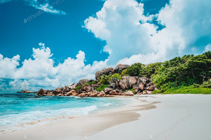 Grand Anse exotic pristine beach at La Digue island in Seychelles. White sandy beach with blue ocean