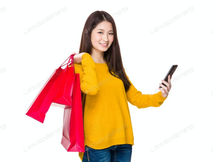 Woman hold shopping bag and mobile phone