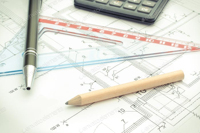 Drawing accesories and calculator on housing plan, building home cost concept