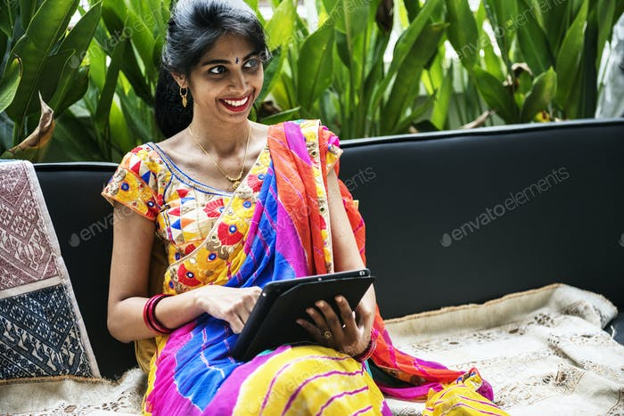 Indian woman using digital tablet