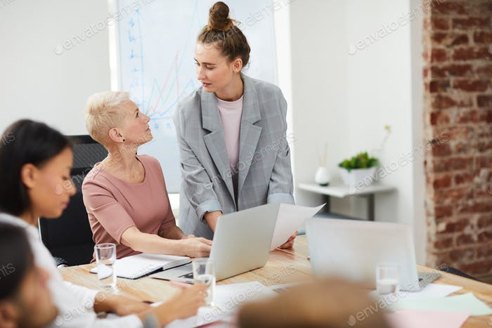 Mature Female Boss in Meeting