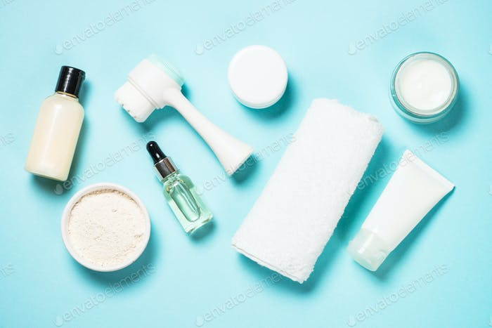 Skin care product on blue background top view