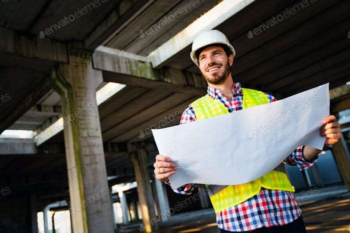 Portrait of construction architect, engineer working on building site