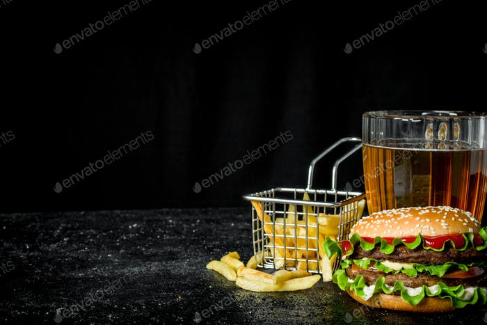 Burger with fries and beer.