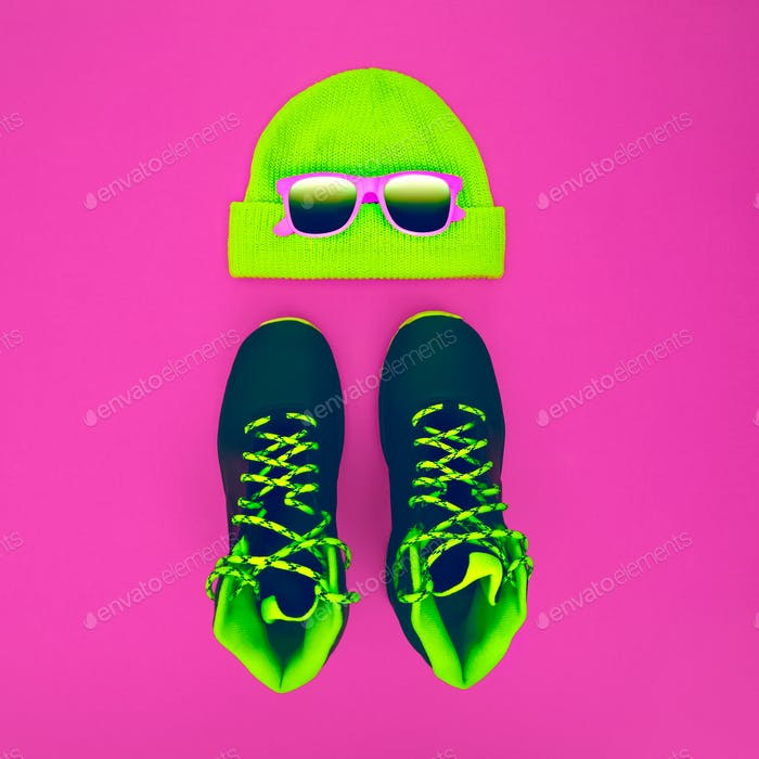 Stylish fashion sport accessories: sneakers, sunglasses, hat on
