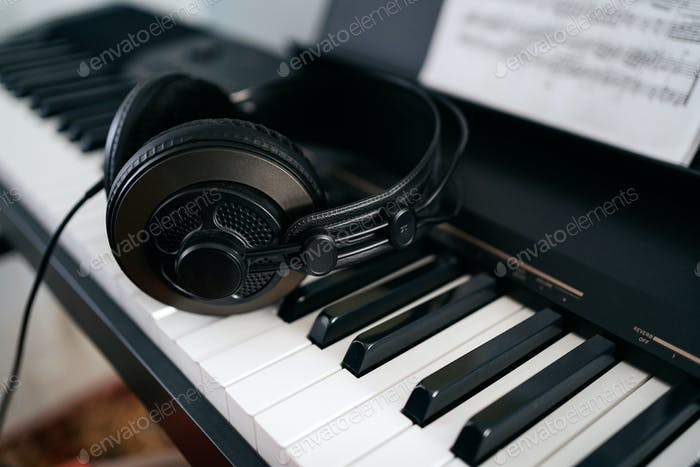 Headphones that lying down on the keyboard
