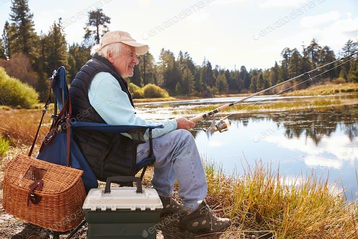 Senior man fishing in a lake, Big Bear, California, close-up