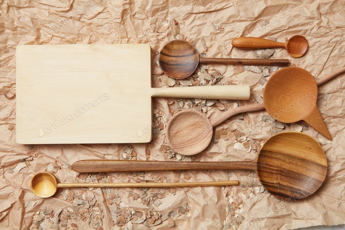 wooden kitchen utensil on baking paper