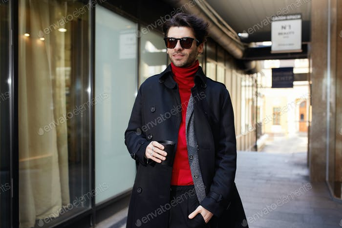 Fashionable young pretty brown haired unshaved man in sunglasses