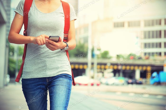 Walking and use mobile phone on street