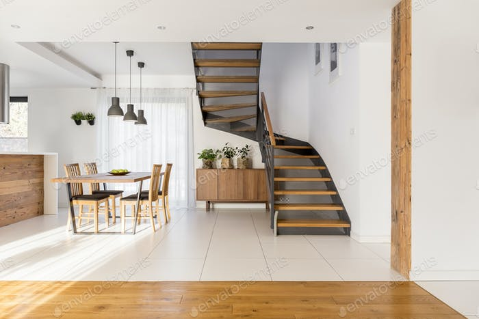Half-landing stairs and wooden dining area