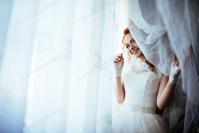Bride near curtains