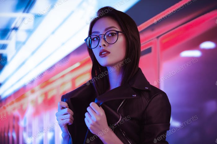 Asian Woman in the City at Night