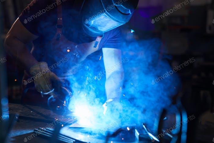 Mechanic using welding torch