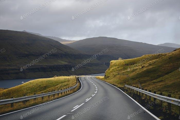 Curvy mountain highway in Faroe islands