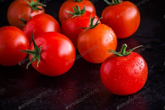 fresh organic cherry tomatoes with drops closeup