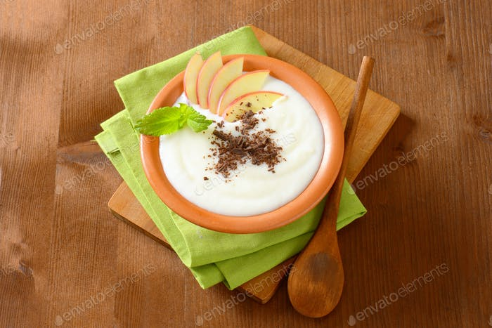 Semolina or rice pudding with apple and chocolate
