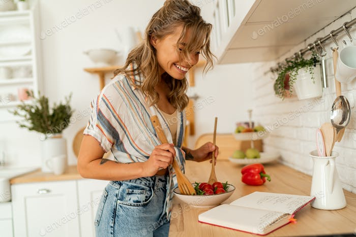 housewife woman looking at recipe in cookery book